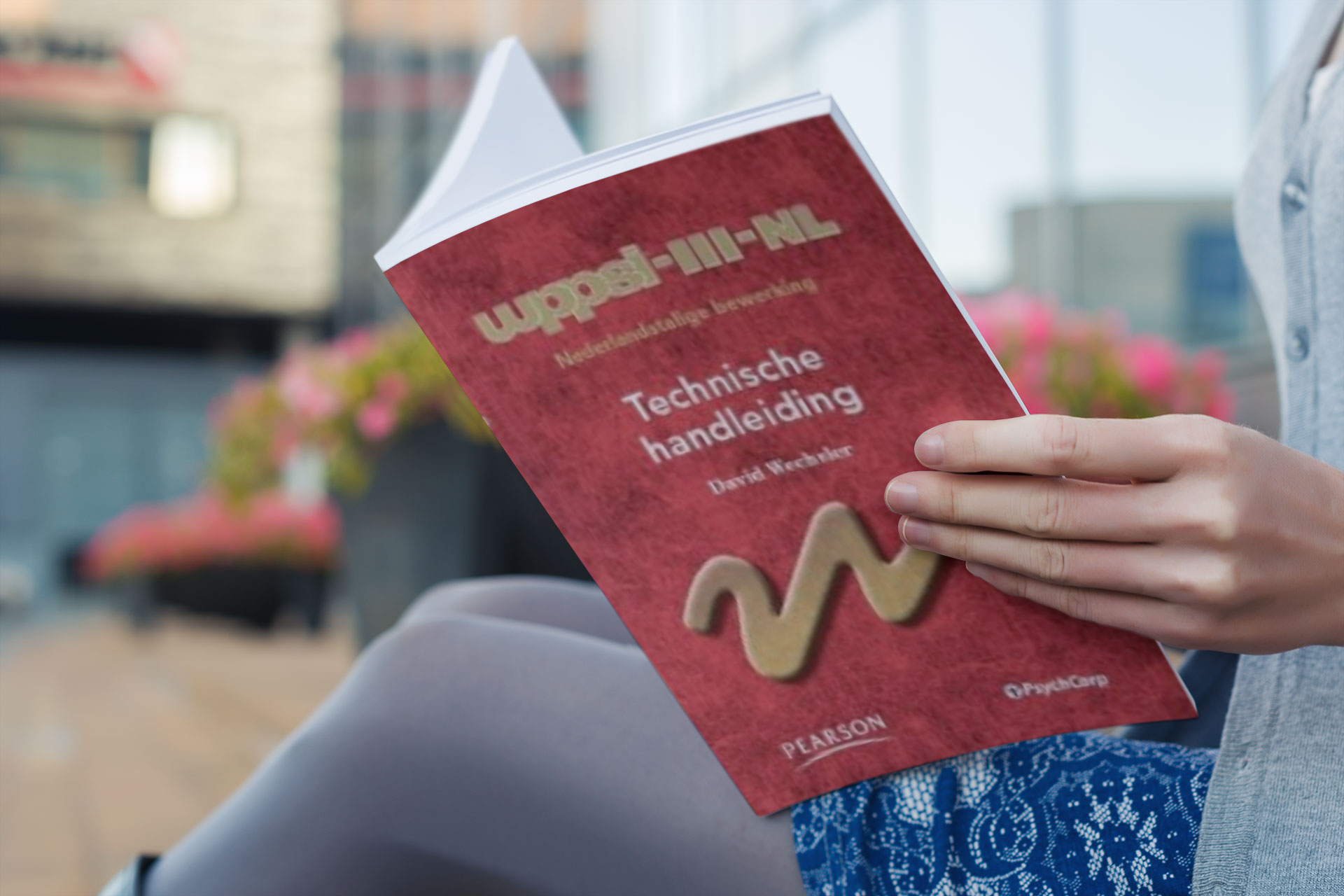 mockup-of-a-woman-reading-a-softcover-book-3418-el1